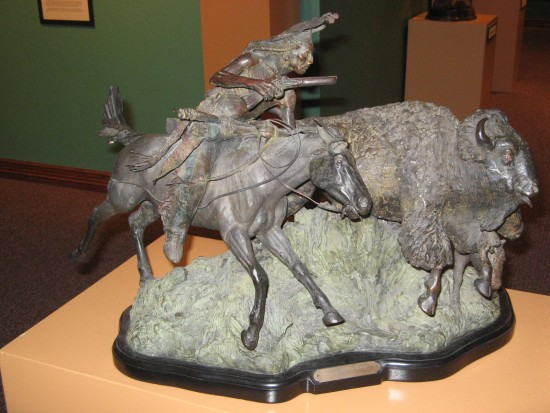 Bronze piece shows intricate details of animals